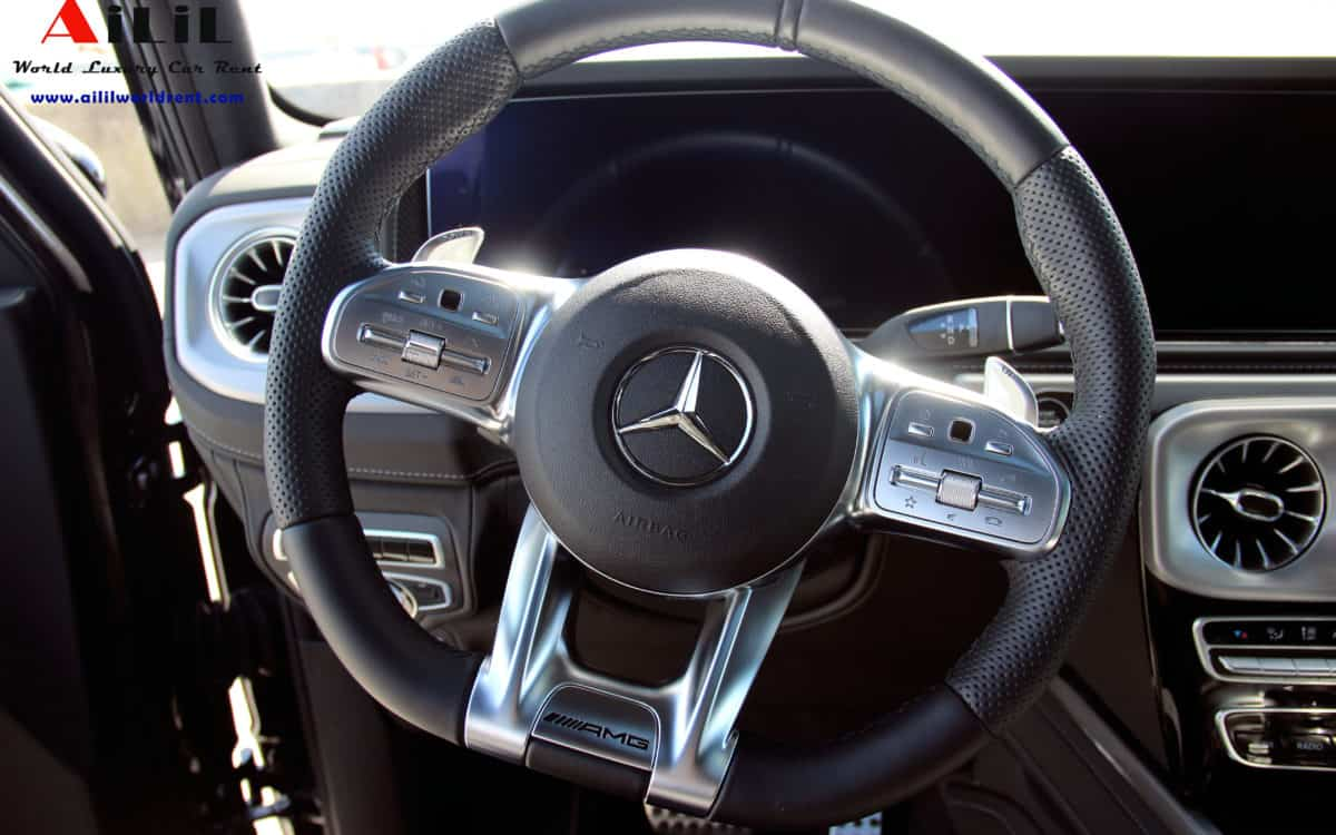 rent-new-mercedes-g63-blck.steering-wheel-ailil-world-rent